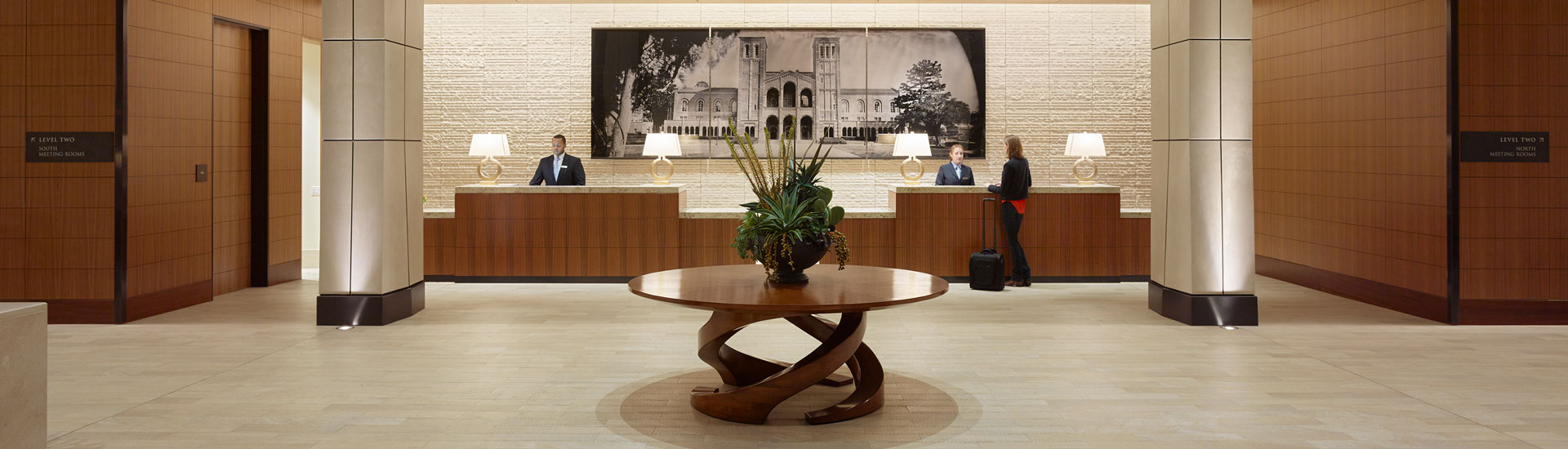 two workers at the lobby front desk
