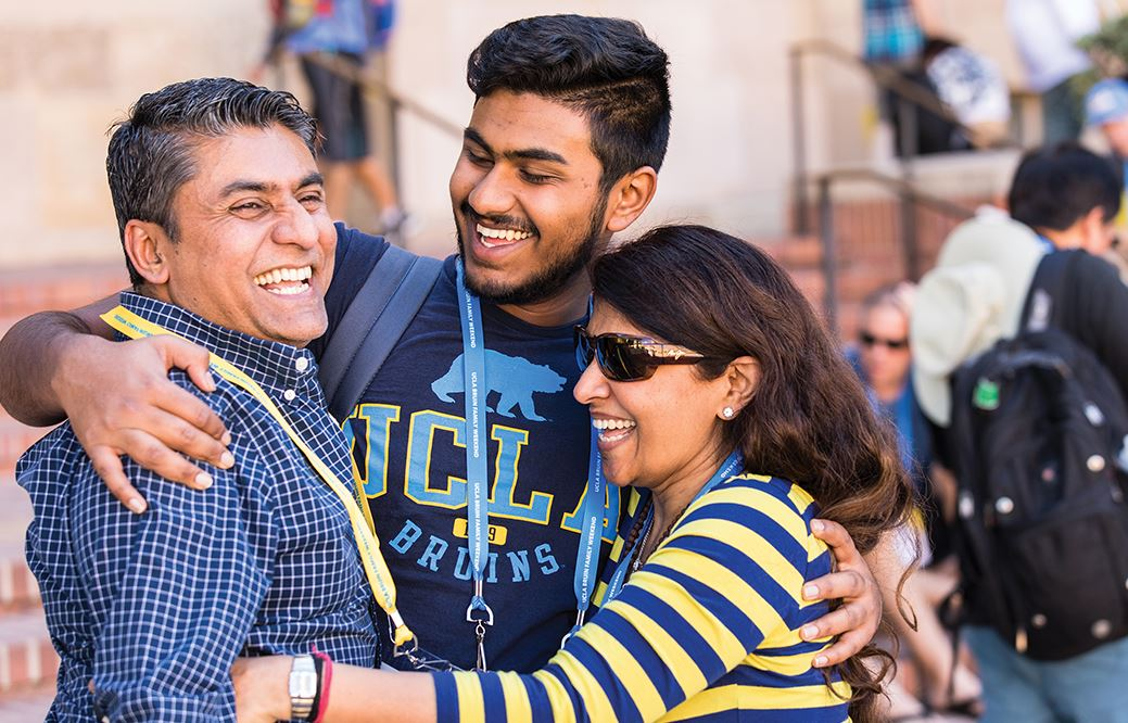 A UCLA student with his parents